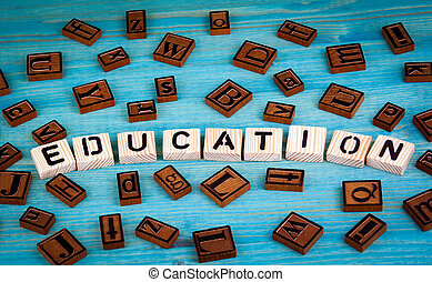 education word written on wood block. Wooden alphabet on a blue background