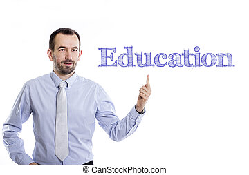 Education - Young businessman with small beard pointing up in blue shirt