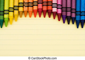 Educational background - Colorful crayons on a sheet of...