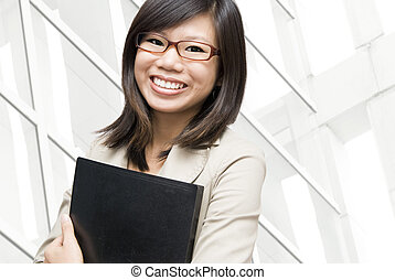 Educational / business people. - Young Asian women holding a...