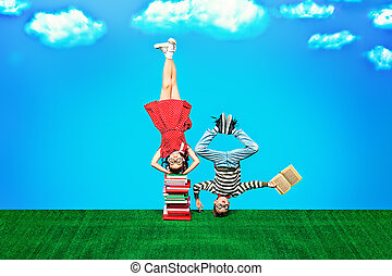 educational concept - Two happy children standing on their...