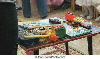 Educational games. Children's books, toys on table