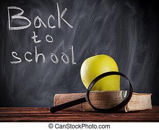 Educational still life with blackboard