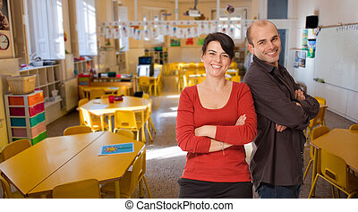 Educational team - Young woman and man smiling on an...