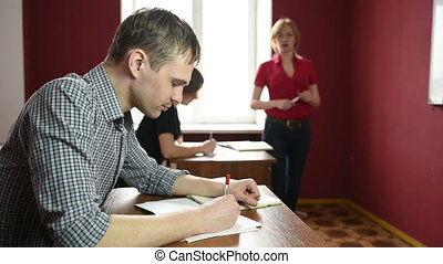 Educational theme: portrait of a teacher giving a lecture....