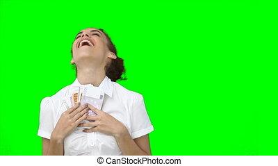 een, glimlachende vrouw, vasthouden, een, ventilator, van, contant, in, haar, hand