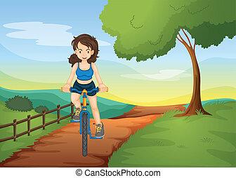een, meisje, paardrijden, op een fiets