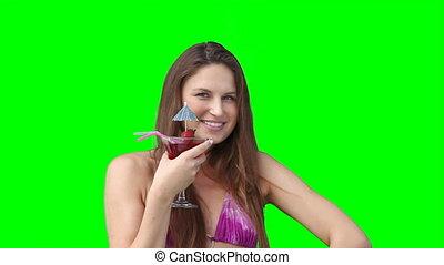 een, vrouw glimlachen, met, een, drank, in, haar, hand