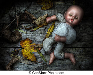 Eerie image of an abandoned doll. - Eerie grunge / High...