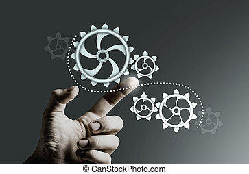 Concept of harmonious working mechanism with finger pointing at gears and cogwheels