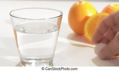 vitamin c - effervescent tablet in a glass of water, vitamin...