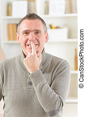 EFT tapping points - Man doing EFT on the under nose point....