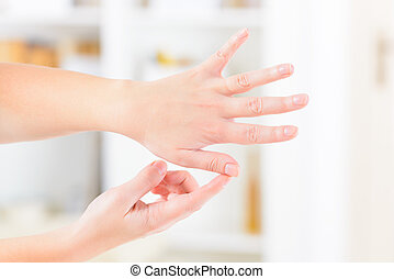 EFT tapping points - Woman doing EFT on the finger point....