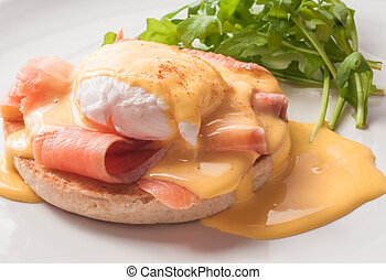 Egg Benedict with smoked salmon and Hollandaise sauce.