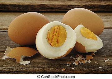 Egg boiled on old wooden background