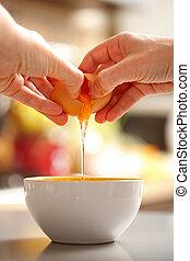 Egg cracking - Food preparing, back view of hands cracking...