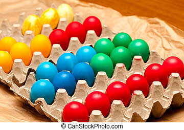 Eggs just colored on egg crate.
