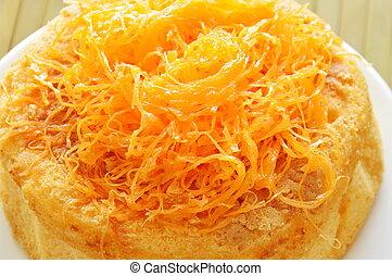 egg golden threads topping butter cake on dish