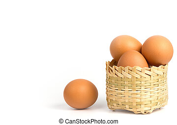 Egg in the bamboo basket on white background.