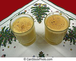 Egg Nog - Two glasses of egg nog on a Christmas napkin.