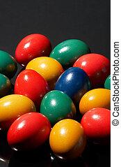 egg-o-mania - many coloured eggs on black background - ...