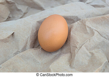 Egg on the brown paper.