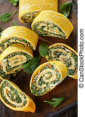 egg rolls with spinach on cutting board