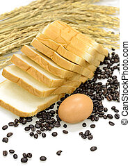 Egg, sliced bread, coffee beans and ears of wheat on white background.