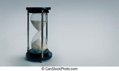Egg Timer Running Down - Egg timer on plain background with...