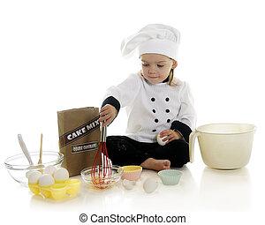 """Egg Whisking - An adorable preschool """"chef"""" whisking eggs..."""