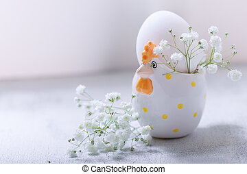 Egg with flowers on a white background. Easter Symbols.