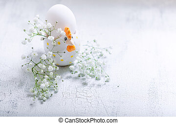 Egg with Gypsophila on a white background.
