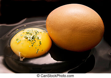 egg yolk and isolated on black background