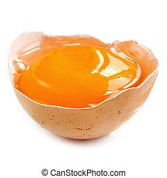 Egg Yolk in Shell over White - Egg yolk in brown eggshell,...