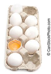 Egg, yolk in shell - Egg in packing, one is, yolk in shell