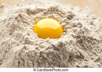 Egg yolk on buckwheat flour. - Egg yolk on top of buckwheat...