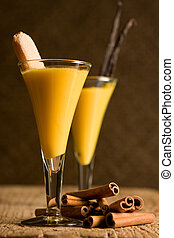 "Eggnog for two - Two glasses with eggnog or ""Advocaat""..."