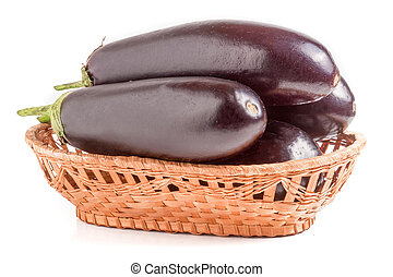 eggplant in a wicker basket isolated on white background