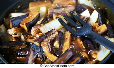 Eggplant In Soy Sauce - Slices of eggplants and onions in...