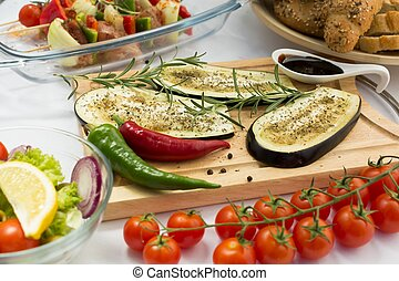Eggplant on cutting board - Three slices of flavored fresh...