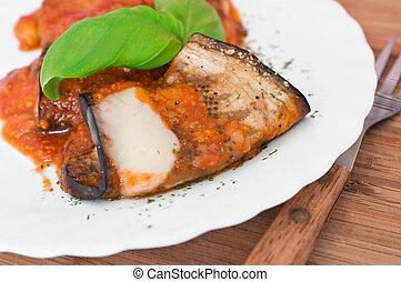 Eggplant rolls with tomato sauce.