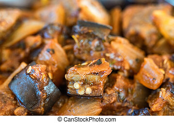 Eggplant stew with meat close up view