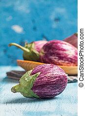 Eggplant varieties in wooden bowl