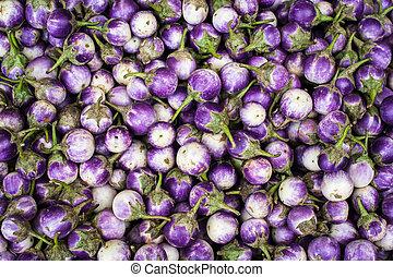 Eggplants at asian market. Organic food background