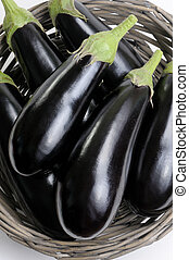 Eggplants. - Eggplants of black colour in a basket