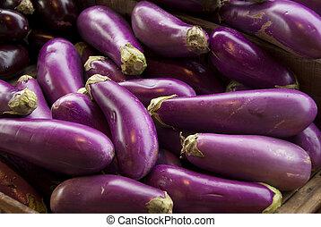 Eggplants in farmer's market stand