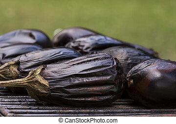 Eggplants roasting upon the campfire