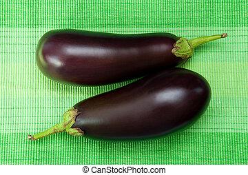 Eggplants - Two fresh eggplants on the green background