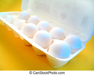 Eggs - A carton of eggs. Yellow surface and blue highlights.