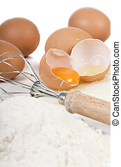 Eggs and Flour - A broken egg ready to be mixed into the...